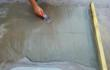 Garlands new Quick-Slope modified acrylic cementitious material is easy to apply and redirects or disperses harmful standing water on low-slope modified bitumen roofs photo